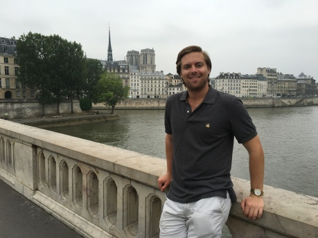 Me leaning on a bridge in Paris over the Seine